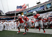 The Ohio State Buckeyes run on to the field before the college football game between the Ohio State Buckeyes and the Navy Midshipmen at M&T Bank Stadium in Baltimore, Saturday afternoon, August 30, 2014. The Ohio State Buckeyes defeated the Navy Midshipmen 34 - 17. (The Columbus Dispatch / Eamon Queeney)