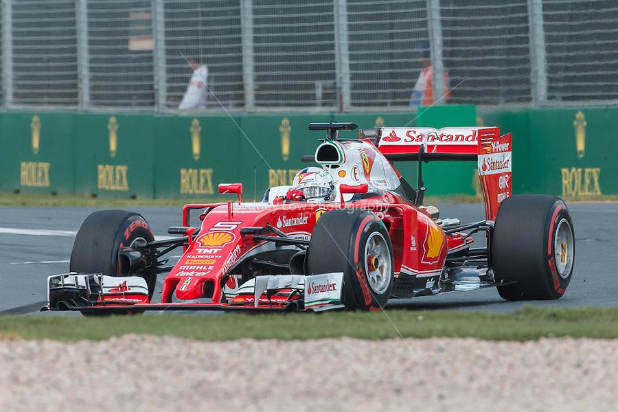 March 20, 2016: Sebastian Vettel (DEU) #5 from the Scuderia Ferrari team at turn one of the 2016 Australian Formula One Grand Prix at Albert Park, Melbourne, Australia. Photo Sydney Low