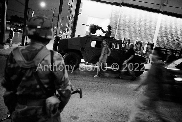 Monterrey, Mexico<br /> June 8, 2007<br /> <br /> The Mexican military patrols San Pedro, a rich neighborhood in Monterrey. They station themselves close to a church were a wedding ceremony is being held for members of a wealthy family. It was attended by some of Mexico's wealthiest people including guest, Santiago Creel, one of the richest men in Mexico.