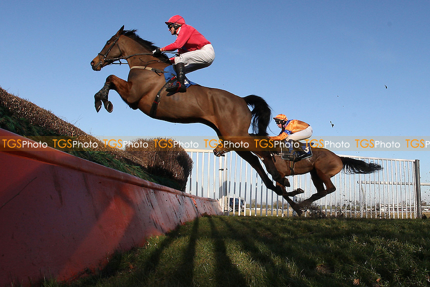 Rockandahardplace ridden by Mr G Barfoot-Saunt in jumping action during the Weatherbys Cheltenham Festival Betting Guide Novices Chase - Horse Racing at Huntingdon Racecourse, Cambridgeshire - 23/02/12- MANDATORY CREDIT: Gavin Ellis/TGSPHOTO - Self billing applies where appropriate - 0845 094 6026 - contact@tgsphoto.co.uk - NO UNPAID USE.