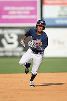 Derian Cruz (4) of the Danville Braves hustles towards third base against the Pulaski Yankees at American Legion Post 325 Field on July 31, 2016 in Danville, Virginia.  The Yankees defeated the Braves 8-3.  (Brian Westerholt/Four Seam Images)