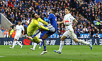 Lukasz Fabianski of Swansea City collides with Riyad Mahrez of Leicester City as he makes a save during the Barclays Premier League match between Leicester City and Swansea City played at The King Power Stadium, Leicester on 24th April 2016