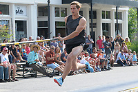 NWA Democrat-Gazette/DAVID GOTTSCHALK Pole vaulter Paula Pujats runs down the ramp for an attempt Thursday, June 7, 2018, as he participates in the Fayetteville Street Vault during the all-day First Thursday, a seasonal event produced by Experience Fayetteville, in downtown Fayetteville. The Fayetteville Advertising and Promotion Commission awarded $10,000 toward the Fayetteville Street Vault event as part of the commission's spring grant program. Some of the athletes who participated in the event were former Olympians.