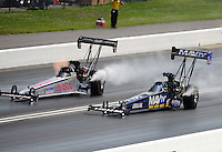 Jun. 16, 2012; Bristol, TN, USA: NHRA top fuel dragster driver Brandon Bernstein (right) races alongside Chris Karamesines during qualifying for the Thunder Valley Nationals at Bristol Dragway. Mandatory Credit: Mark J. Rebilas-