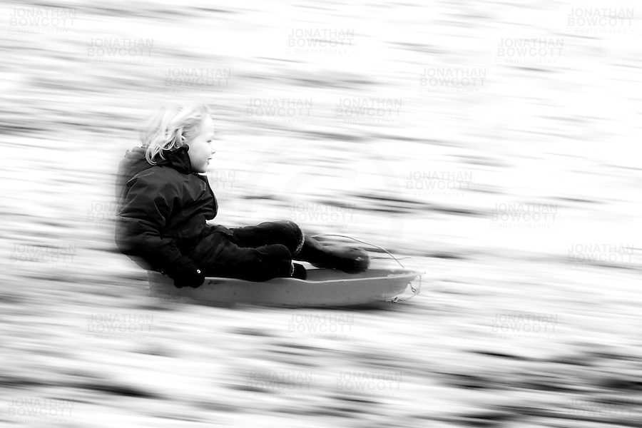 A 5 year old boy enjoys an exhilarating, speedy run down the hill in Redland Green Park, Bristol during the January 2013 snowy spell.