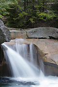 """""""The Basin"""" in Franconia Notch State Park of the White Mountains, New Hampshire during the spring months. This natural feature is along the Pemigewasset River."""