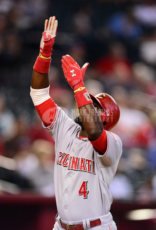 Aug. 29, 2012; Phoenix, AZ, USA: Cincinnati Reds shortstop Brandon Phillips celebrates a home run against the Arizona Diamondbacks at Chase Field. Mandatory Credit: Mark J. Rebilas-USA TODAY Sports