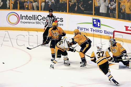 June 5th 2017, Nashiville, TN, USA;  Referee Kevin Pollock (33) looks on as Nashville Predators defenseman Mattias Ekholm (14) and Pittsburgh Penguins right wing Josh Archibald (45) battle for position during Game 4 of the Stanley Cup Final between the Nashville Predators and the Pittsburgh Penguins, held on June 5, 2017, at Bridgestone Arena in Nashville, Tennessee. Ekholm received a roughing and slashing penalty on the play. Archibald received a slashing penalty.