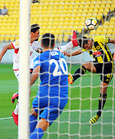 Wellington's Andrija Kaluderovic tries to head for goal under pressure during the A-League football match between Wellington Phoenix and Adelaide United at Westpac Stadium in Wellington, New Zealand on Saturday, 27 January 2018. Photo: Dave Lintott / lintottphoto.co.nz