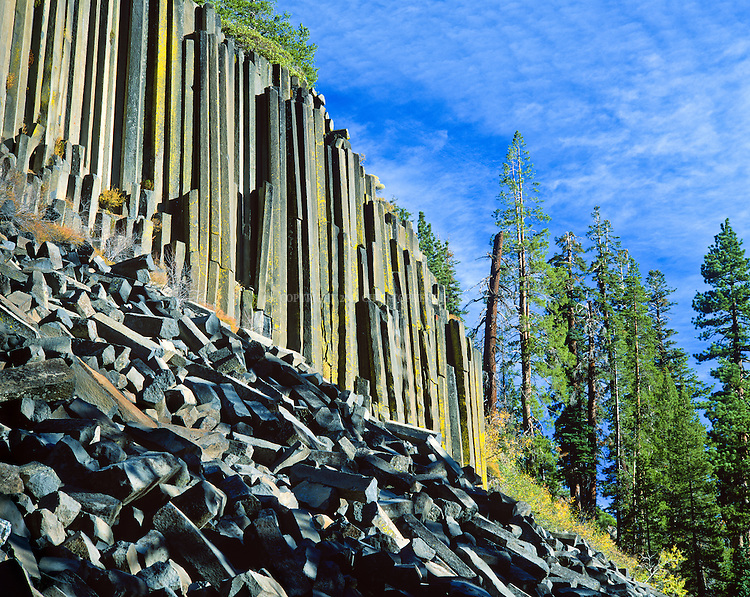 Devils Postpile National Monument, Est. 1911, 798 acres (3.23 km2). Devils Postpile, a cliff of long, symmetric columnar basalt created by a lava flow sometime between less than 100,000 to 700,000 years ago (depending on dating method) and exposed through glacier movement. Columns average 2 feet (0.61 m) in diameter, largest being 3.5 feet (1.1 m), many are up to 60 feet (18 m) long. A survey of 400 columns found 44.5% were 6-sided, 37.5% 5-sided, 9.5% 4-sided, 8.0% 7-sided, and 0.5% 3-sided. Inyo County, CA. Postpile National Monument, Est. 1911, 798 acres (3.23 km2). Devils Postpile, a cliff of long, symmetric columnar basalt created by a lava flow sometime between less than 100,000 to 700,000 years ago (depending on dating method) and exposed through glacier movement. Columns average 2 feet (0.61 m) in diameter, largest being 3.5 feet (1.1 m), many are up to 60 feet (18 m) long. A survey of 400 columns found 44.5% were 6-sided, 37.5% 5-sided, 9.5% 4-sided, 8.0% 7-sided, and 0.5% 3-sided. Inyo County, CA.