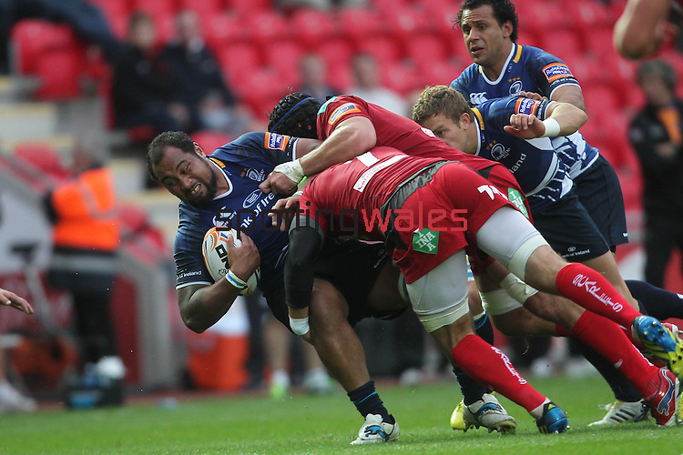 Leo Auva'a is forced back by the Scarlets defence..RaboDirect Pro12.Scarlets v Leinster.Parc y Scarlets.01.09.12.©Steve Pope