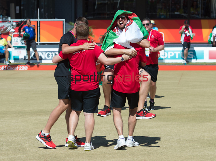 Wales Daniel Salmon and Wales Marc Wyatt celebrate winning the Mens Pairs with the support team <br /> <br /> *This image must be credited to Ian Cook Sportingwales and can only be used in conjunction with this event only*<br /> <br /> 21st Commonwealth Games - Final Mens Pairs Wales v Scotland, Bowls -  Day 5 - 09\04\2018 - Boardbeach Bowls Club - Gold Coast City - Australia