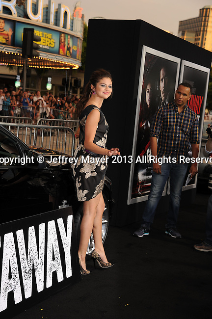 WESTWOOD, CA- AUGUST 26: Actress Selena Gomez arrives at the 'Getaway' - Los Angeles Premiere at Regency Village Theatre on August 26, 2013 in Westwood, California.