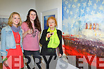 Sarah Wilson, Anna Harms and Noelle Campbell Sharp Ballinskelligs look at Christine Bowen painting Sail On, Sail On, O Mighty Ship of State! at the Gathering Art exhibition in the Department of Arts, Tourism and the Gaelteacht on Monday evening
