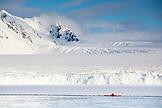 SVALBARD, Longyearban, Kayaker paddling near Glacier of Raudfjordbreen in the Arctic Landscape