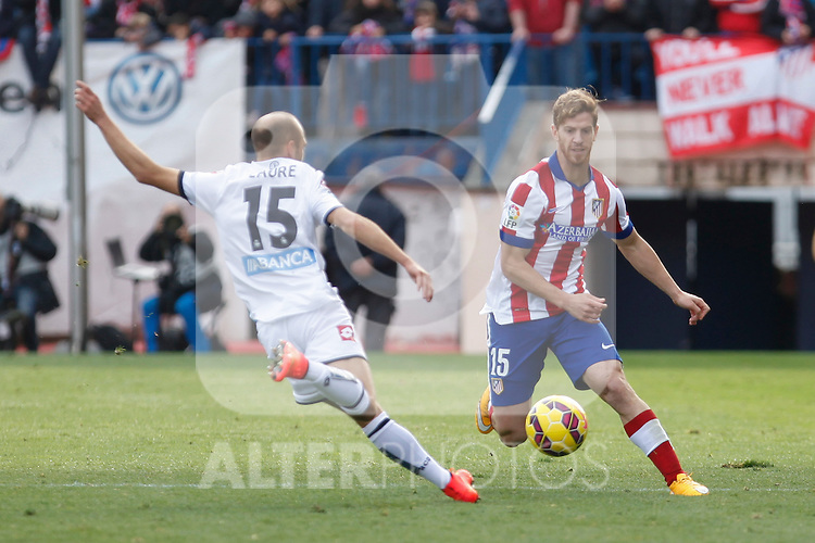 Atletico de Madrid´s Ansaldi (R) and Deportivo de la Coruña´s Laure during 2014-15 La Liga match between Atletico de Madrid and Deportivo de la Coruña at Vicente Calderon stadium in Madrid, Spain. November 30, 2014. (ALTERPHOTOS/Victor Blanco)