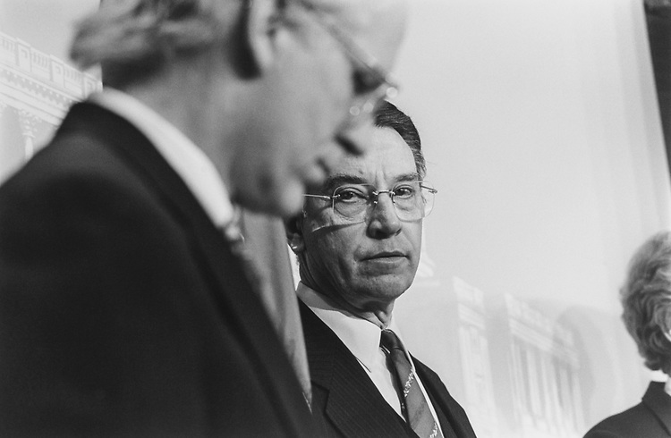 Sen. Chuck Grassley, R-Iowa, at a news conference regarding making Congress more accountable to the laws it enacts. Rep. Chris Shays, R-Conn., is in the foreground, on Feb.23, 1994. (Photo by Maureen Keating/CQ Roll Call via Getty Images)