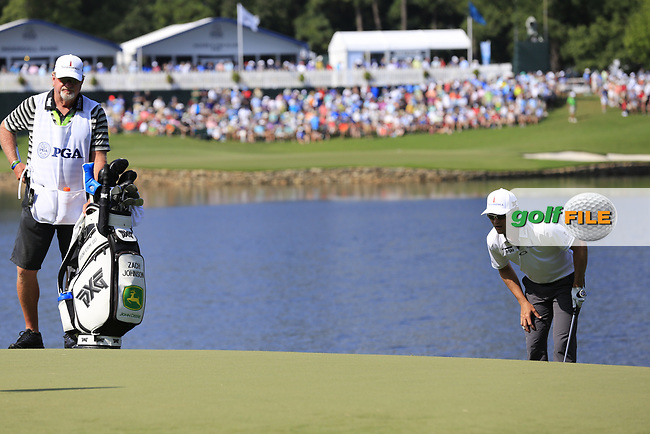 Zach Johnson (USA) and caddy Damon at the 14th green during Thursday's Round 1 of the 2017 PGA Championship held at Quail Hollow Golf Club, Charlotte, North Carolina, USA. 10th August 2017.<br /> Picture: Eoin Clarke | Golffile<br /> <br /> <br /> All photos usage must carry mandatory copyright credit (&copy; Golffile | Eoin Clarke)