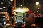 A Bangladeshi girl smokes Sisha in a Sisha lounge in Dhaka, Bangladesh.