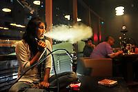 A Bangladeshi girl smokes Sisha in a Sisha lounge in Dhaka, Bangladesh.