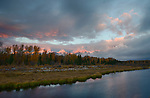 Wyoming, Jackson, Grand Teton National Park. Snow covered peaks kissed with alpenglow on an autumn morning.