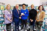 Jon Arsky Arino (Castleisland Comm Coll) received the second prize at the ETB Christmas Card competition at the ETB offices in Centrepoint, Tralee on Monday. L-r, Catherine Lyons (Kerry ETB), Colm McEnvoy (Kerry ETB), Jonarsky Arino (Castleisland Community College), Pia Thornton (Art Teacher, Castleisland Community College) and Ann O'Dwyer (Kerry ETB).
