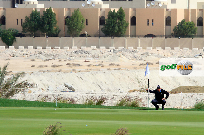 Robert Karlsson (SWE) in action during the first round of .the Commercialbank Qatar Masters presented by Dolphin Energy played at Doha Golf Club, Doha, Qatar on 3rd February 2011..Picture: Phil Inglis / www.golffile.ie.