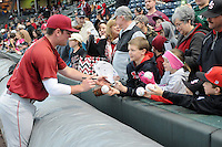 Joey Pankake (9) of the South Carolina Gamecocks signs autographs before a game against the Furman Paladins on Tuesday, April 8, 2014, at Fluor Field at the West End in Greenville, South Carolina. (Tom Priddy/Four Seam Images)