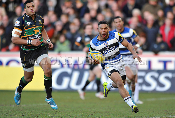 Kyle Eastmond runs in a try for Bath. Aviva Premiership match, between Northampton Saints and Bath Rugby on December 28, 2013 at Franklin's Gardens in Northampton, England. Photo by: Patrick Khachfe / Onside Images