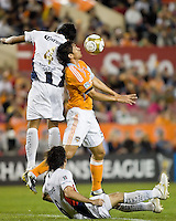Houston Dynamo forward Brian Ching (25) heads the ball away from Atlante FC defender Luis Venegas (4) and Atlante FC midfielder Gerardo Espinoza (6).  Houston Dynamo tied Atlante FC 1-1 at Robertson Stadium in Houston, TX on February 24, 2009 in CONCACAF Champions League play .  Photo by Wendy Larsen/isiphotos.com