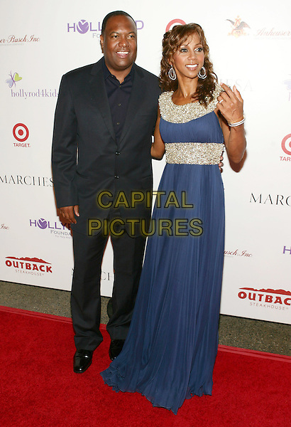 RODNEY PEETE & HOLLY ROBINSON PEETE.11th Annual DesignCare event benefiting the HollyRod Foundation held at a Private Residence, Beverly Hills, CA, USA..July 25th, 2009.full length black suit blue jewel encrusted embellished married husband wife silver dress .CAP/ADM/TL.©Tony Lowe/AdMedia/Capital Pictures.
