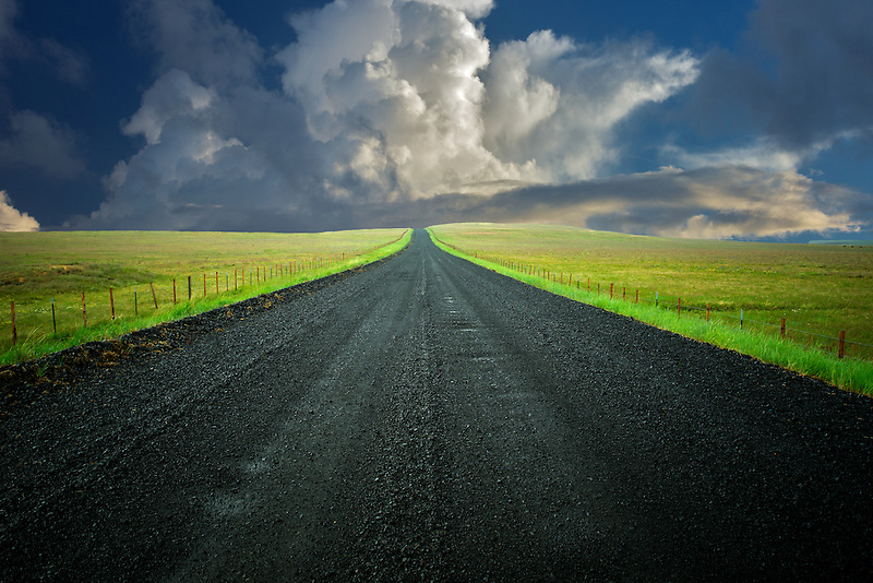 Road in Zumwalt Prarie Preserve with storm clouds, Oregon