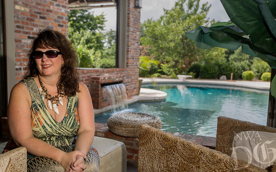 NWA Democrat-Gazette/JASON IVESTER --07/03/2015--<br /> Chrisitine Meier; photographed on Friday, July 3, 2015, in her favorite place, the pool behind her Springdale home