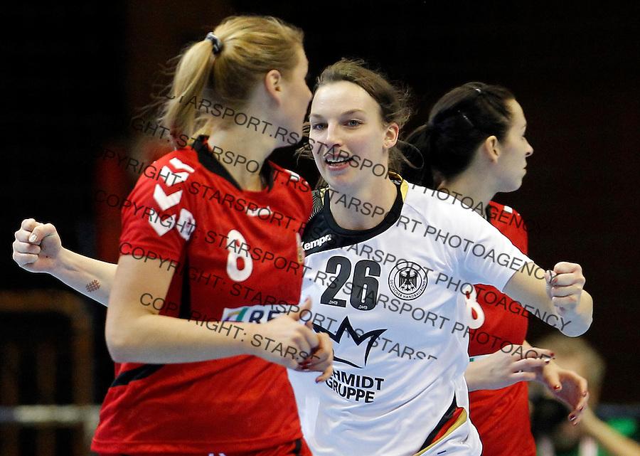 Germanyís Angie Geschake (C) celebrate during Women's Handball World Championship 2013 match Czech Republic vs Germany on December 9, 2013 in Novi Sad.   AFP PHOTO / PEDJA MILOSAVLJEVIC