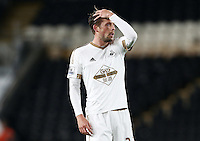Gylfi Sigurosson of Swansea City looks dejected during the Capital One Cup match between Hull City and Swansea City played at the Kingston Communications Stadium, Hull