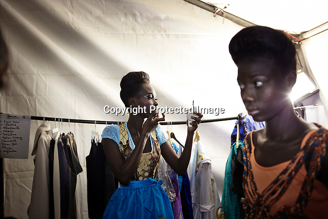 DAKAR, SENEGAL - JUNE 21: Models walking for designer label Time 4 Africa wait backstage before a fashion show at Dakar Fashion Week on June 21, 2014, at Hotel des Almadies in Dakar, Senegal. Seventeen Senegalese, African and foreign-based designers showed their collections during the 12th edition of Dakar Fashion week. (Photo by Per-Anders Pettersson)