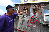 NWA Democrat-Gazette/J.T. WAMPLER Adam Nelson points to an old mule harness and plow Sunday July 7, 2019 decorating his barbecue food truck in Bethel Heights. Nelson moved his truck and smokehouse called In-N-Out Smokehouse from Branson and plans on being open Wednesday July 10th. The decorations and the wood for the food truck and smokehouse came from Snelson's grandfather's eighty-year old barn. Nelson smokes pork and cheese.