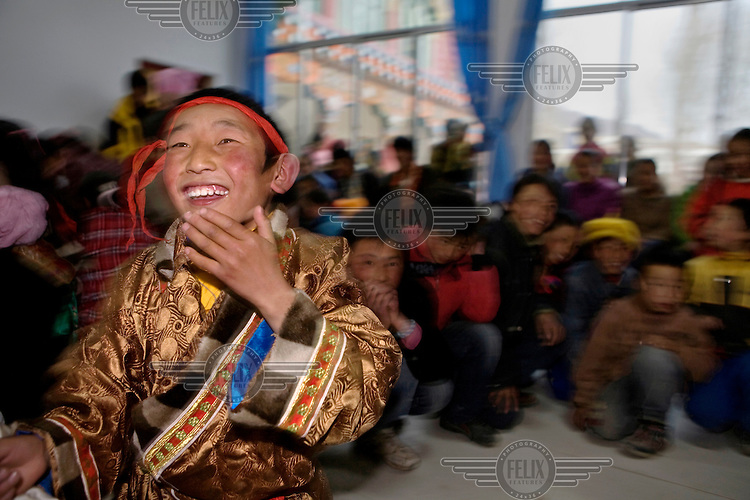 A Khampa boy laughs as he plays games in a town in the far west of the province.