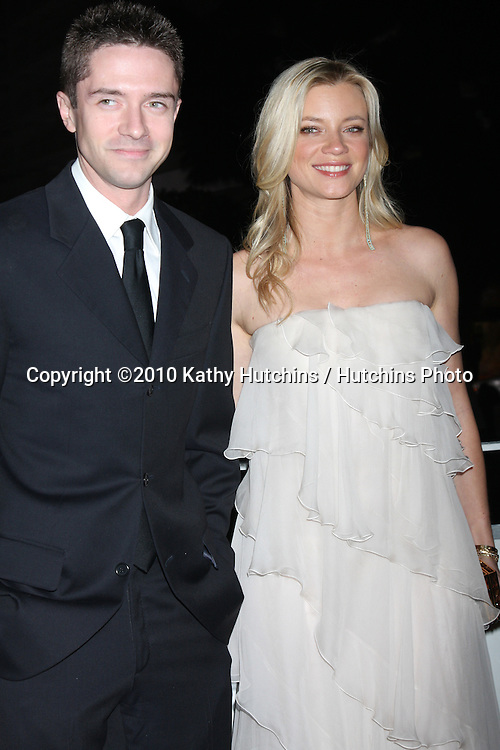 Topher Grace & Amy Smart.arriving at the 3rd Annual Art of Elysium Gala.Rooftop of Parking Garage across from Beverly Hilton Hotel.Beverly Hills, CA.January 16, 2010.©2010 Kathy Hutchins / Hutchins Photo....