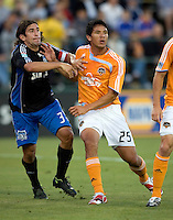 22 May 2008:  Nick Garcia of the Earthquakes battles for a corner ball kick against Brian Ching of the Dynamo during the game at Buck Shaw Stadium in San Jose, California.   San Jose Earthquakes defeated Houston Dynamo, 2-1.