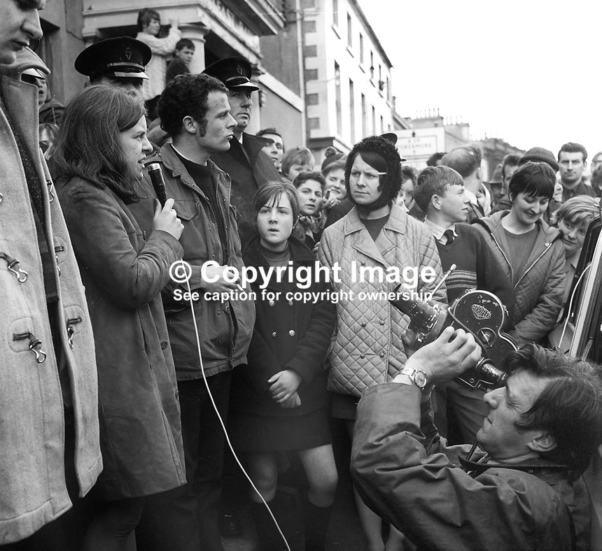Bernadette Devlin, People's Democracy, civil rights activist, campaigning in Moneymore, village, Co Londonderry, as a Unity candidate in the April 1969 Mid-Ulster by-election for the UK Parliament in London. She defeated  Anna Forest, the widow, of the previous incumbent. At 21 years old  Bernadette Devlin was the youngest Westminster MP at the time. Beside her is Eamonn McCann, civil rights activist &amp; journalist. 196904000150a<br />