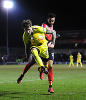 Cheltenham Town's Joe Rodon under pressure from Lincoln City's Matt Green<br /> <br /> Photographer Chris Vaughan/CameraSport<br /> <br /> The EFL Sky Bet League Two - Lincoln City v Cheltenham Town - Tuesday 13th February 2018 - Sincil Bank - Lincoln<br /> <br /> World Copyright &copy; 2018 CameraSport. All rights reserved. 43 Linden Ave. Countesthorpe. Leicester. England. LE8 5PG - Tel: +44 (0) 116 277 4147 - admin@camerasport.com - www.camerasport.com