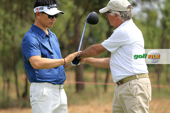 Getting 1st hand tuition from  Y.E.Yang (KOR) on the 4th tee during the Pro-Am of the Open de Espana  in Club de Golf el Prat, Barcelona on Wednesday 13th May 2015.<br /> Picture:  Thos Caffrey / www.golffile.ie