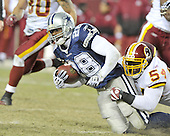 Landover, MD - December 27, 2009 -- Dallas Cowboys running back Felix Jones (28) is tackled by Washington Redskins linebacker H.B. Blades (54) in fourth quarter action at FedEx Field in Landover, Maryland on Sunday, December 27, 2009.  The Cowboys won the game 17 - 0..Credit: Ron Sachs / CNP.(RESTRICTION: NO New York or New Jersey Newspapers or newspapers within a 75 mile radius of New York City)