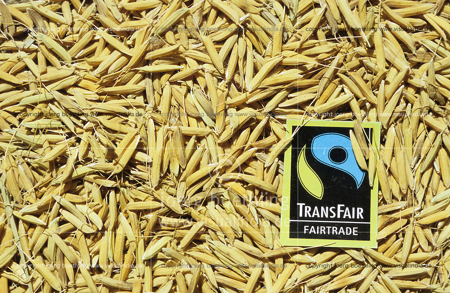 INDIEN Transfair Label, Fairtrade und Bio Basmati Reis Projekt Khaddar Farmer bei Dehradun / INDIA, Transfair Label, fair trade and organic Basmati rice project of Khaddar Farmers near Dehradun , unpeeled rice grain with label