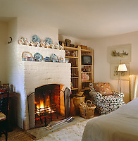 A crackling fire provides a focal point in this small cosy bedroom