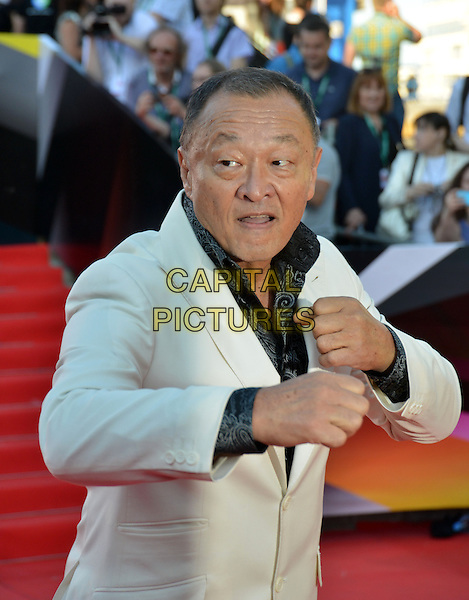 Cary-Hiroyuki Tagawa<br /> The opening of the Moscow International Film Festival, Moscow, Russia.<br /> June 20th, 2013<br /> half length white suit jacket black shirt hands arms fists <br /> CAP/PER/LS<br /> &copy;LS/PersonaStars/CapitalPictures
