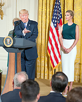 United States President Donald J. Trump makes remarks at an event with small businesses in the East Room of the White House in Washington, DC on Tuesday, August 1, 2017.  At right is Ivanka Trump. Photo Credit: Ron Sachs/CNP/AdMedia