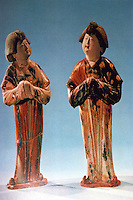 China:  Three-color glazed figurines of women.  Tang Dynasty 618-907 A.D.