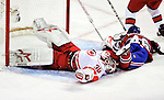 31 March 2010: Carolina Hurricanes' goaltender Cam Ward is sprawled out in his crease after making a first period save against the Montreal Canadiens at the Bell Centre in Montreal, Quebec, Canada. The Hurricanes defeated the Canadiens 2-1 in their last meeting of the regular season. Mandatory Credit: Ed Wolfstein Photo